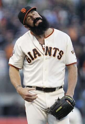 FILE - In this July 10, 2011, file photo, San Francisco Giants pitcher Brian Wilson adjusts his neck during the ninth inning of a baseball game against the New York Mets in San Francisco. Wilson is likely headed for surgery on his right elbow after an MRI showed structural damage and an issue with the ligament, and his season could be in jeopardy. Manager Bruce Bochy and athletic trainer Dave Groeschner say the club will seek at least one other opinion and probably two, including from the renowned orthopedist Dr. James Andrews, who performs Tommy John elbow-reconstruction surgeries. (AP Photo/Ben Margot, File) Photo: Ben Margot, Associated Press