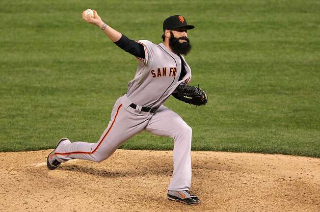 Brian Wilson #38 of the San Francisco Giants pitches in relief against the Colorado Rockies at Coors Field on April 11, 2012 in Denver, Colorado. The Rockies defeated the Giants 17-8. Photo: Doug Pensinger, Getty Images