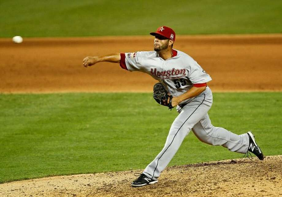 Wilton Lopez throws a pitch. (Mike Ehrmann / Getty Images)