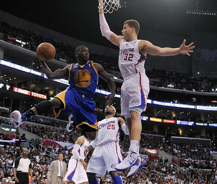 Golden State Warriors guard Nate Robinson, left, passes around Los Angeles Clippers forward Blake Griffin (32) during the second half of an NBA basketball game in Los Angeles, Saturday, April 14, 2012. Photo: Chris Carlson, Associated Press