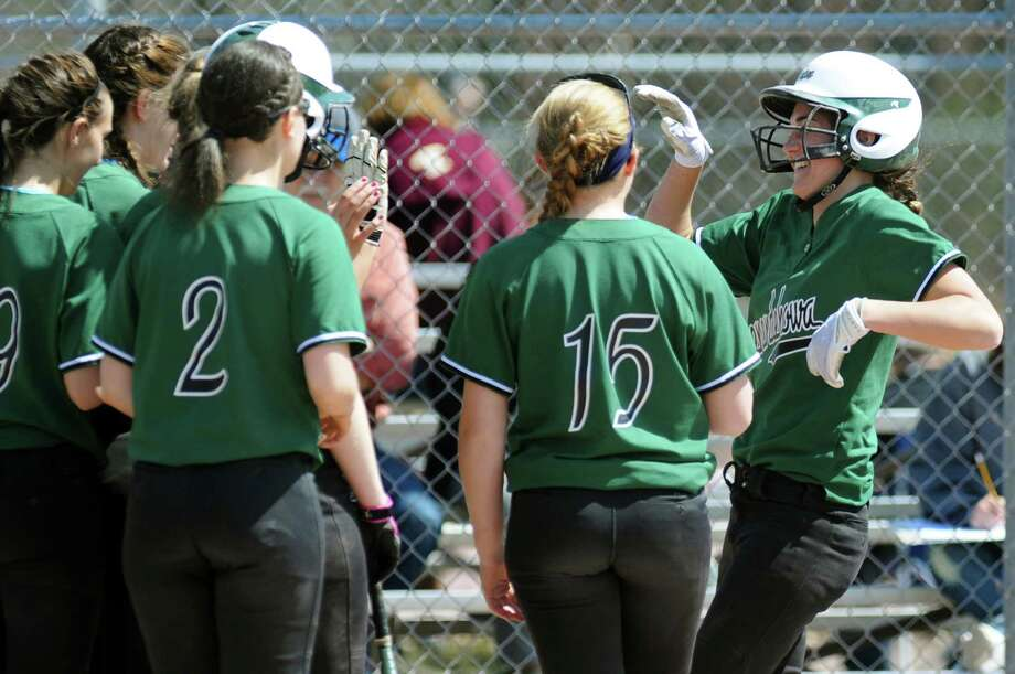 Shenendehowa's Caitlin Lawson (1), right, celebrates her second home run during their softball game against Newburgh Free Academy during the Christina Massa Memorial Softball Tournament on Saturday, April 14, 2012, at Clifton Park Commons in Clifton Park, N.Y. (Cindy Schultz / Times Union) Photo: Cindy Schultz / 00017232A