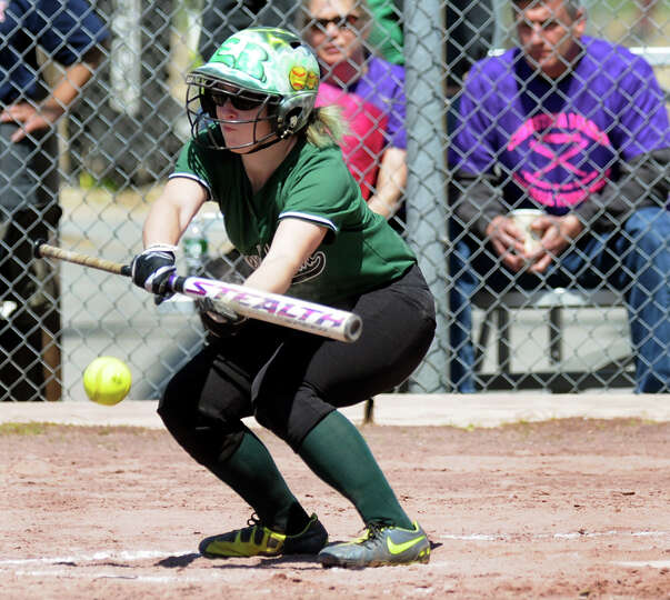Shenendehowa's Erin Buckley bunts the ball during their softball game against Newburgh Free Academy
