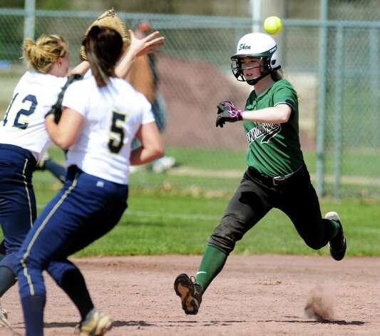 Shenendehowa's Aly Kramer, right, gets caught in a rundown between first and second with Newburgh Free Academy's Kristen Steele (12), left, during their softball game against during the Christina Massa Memorial Softball Tournament on Saturday, April 14, 2012, at Clifton Park Commons in Clifton Park, N.Y. (Cindy Schultz / Times Union) Photo: Cindy Schultz / 00017232A