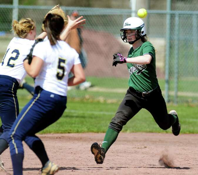 Shenendehowa's Aly Kramer, right, gets caught in a rundown between first and second with Newburgh Fr