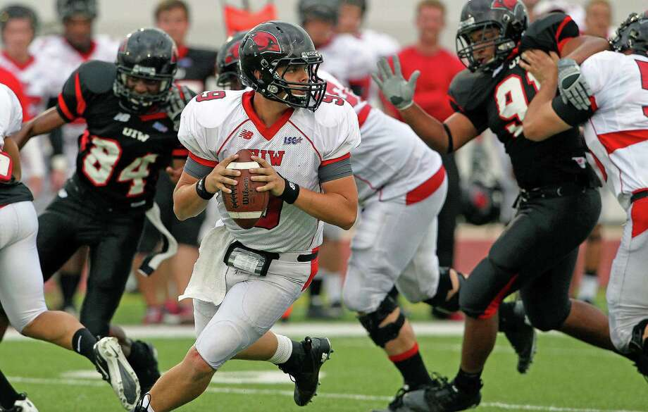 Shane Knight rolls out of the backfield as the University of the Incarnate Word Cardinals play their spring game at Benson Field on  April 14, 2012.  Tom Reel/ San Antoniopress-News Photo: TOM REEL, Express-News / San Antonio Express-News