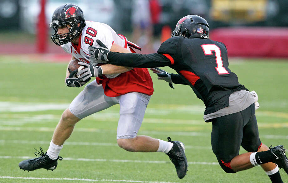 Andrew Mocio twists away from Chaz Pavliska as the University of the Incarnate Word Cardinals play their spring game at Benson Field on  April 14, 2012.  Tom Reel/ San Antoniopress-News Photo: TOM REEL, Express-News / San Antonio Express-News