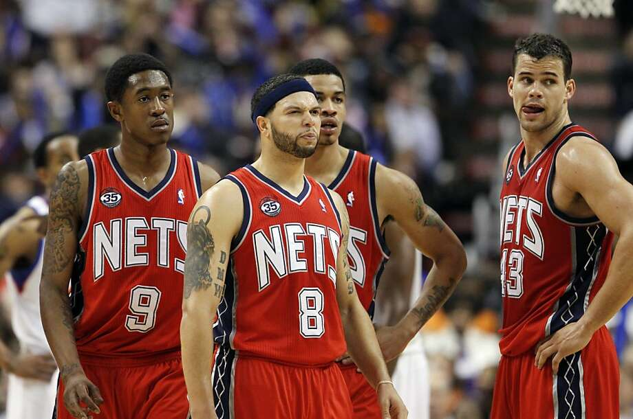 New Jersey Nets guard MarShon Brooks (9), guard Deron Williams (8), guard Gerald Green (14), and forward Kris Humphries (43) look toward the bench in the second half of an NBA basketball game with the Philadelphia 76ers Friday, April 13, 2012 in Philadelphia. Nets won 95-89. (AP Photo/Alex Brandon) Photo: Alex Brandon, Associated Press