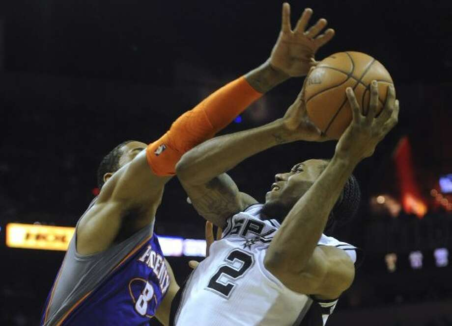 Kawhi Leonard (2) of the San Antonio Spurs is fouled by Channing Frye (8) of the Phoenix Suns during NBA action at the AT&T Center on Saturday, April 14, 2012. Leonard made the shot and converted the ensuing free throw. Billy Calzada / San Antonio Express-News (San Antonio Express-News)
