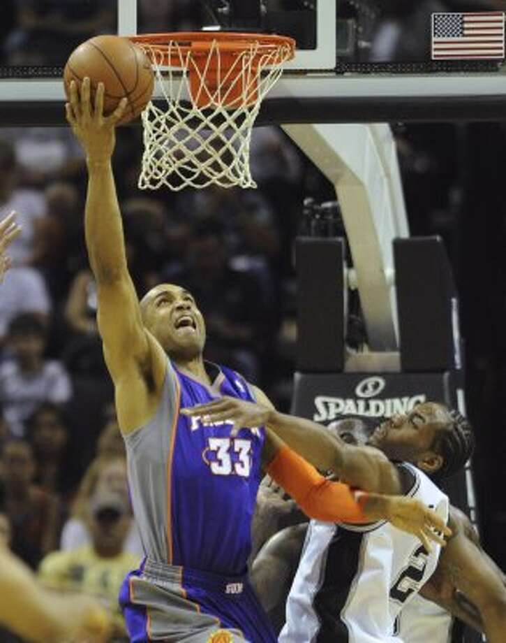 Grant Hill (33) of the Phoenix Suns is unable to sink a layup as Kawhi Leonard (2) of the San Antonio Spurs defends during NBA action at the AT&T Center on Saturday, April 14, 2012. Billy Calzada / San Antonio Express-News (San Antonio Express-News)