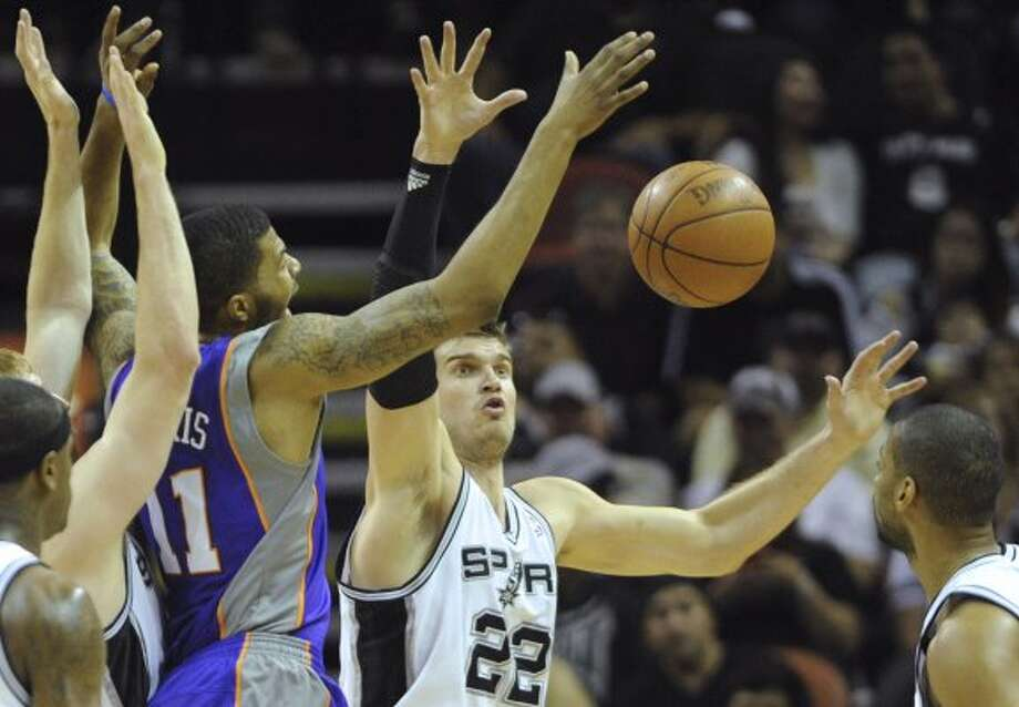 Tiago Splitter (22) of the San Antonio Spurs battles Markieff Morris (11) of the Phoenix Suns for a loose ball during NBA action at the AT&T Center on Saturday, April 14, 2012. Billy Calzada / San Antonio Express-News (San Antonio Express-News)