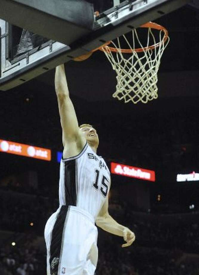 Matt Bonner of the Spurs dunks after a steal against the Phoenix Suns during NBA action at the AT&T Center on Saturday, April 14, 2012. Billy Calzada / San Antonio Express-News (San Antonio Express-News)