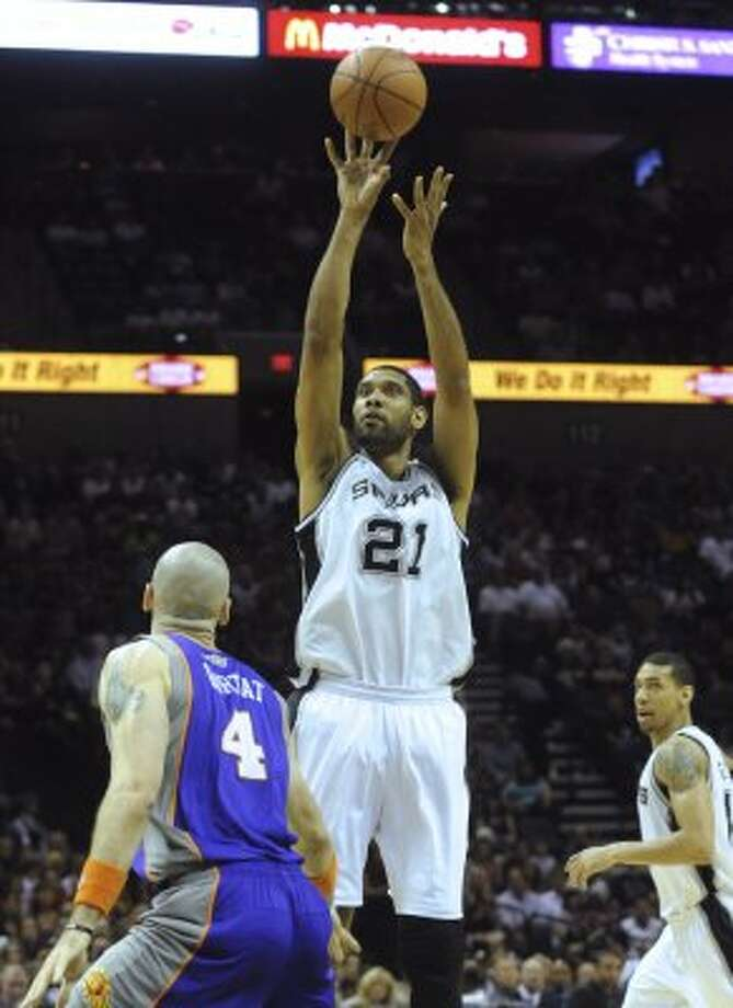 Tim Duncan scores on this shot against Phoenix during first-half NBA action at the AT&T Center on Saturday, April 14, 2012. Billy Calzada / San Antonio Express-News (San Antonio Express-News)