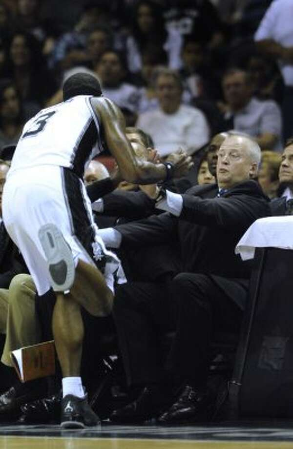 Stephen Jackson of the San Antonio Spurs (3) runs out of bounds toward head trainer Will Sevening during NBA action at the AT&T Center on Saturday, April 14, 2012. Billy Calzada / San Antonio Express-News (San Antonio Express-News)