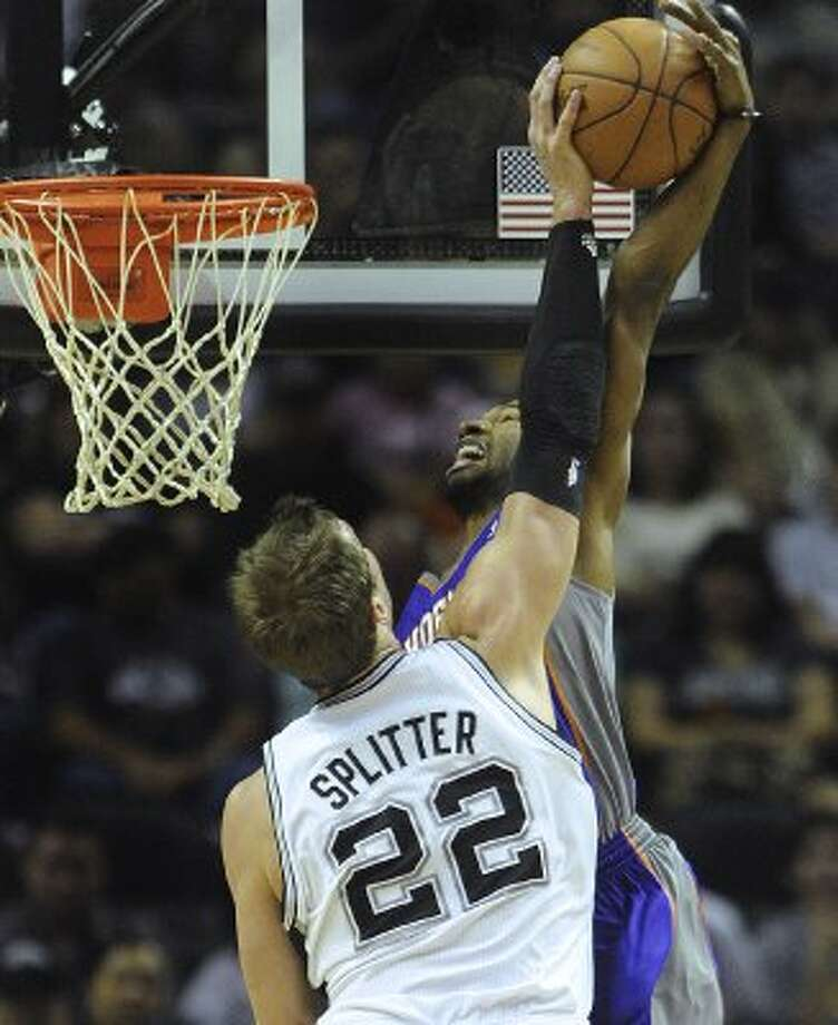 Tiago Splitter of the San Antonio Spurs (22) blocks an attempted dunk by Michael Redd of the Phoenix Suns during NBA action at the AT&T Center on Saturday, April 14, 2012. Billy Calzada / San Antonio Express-News (San Antonio Express-News)
