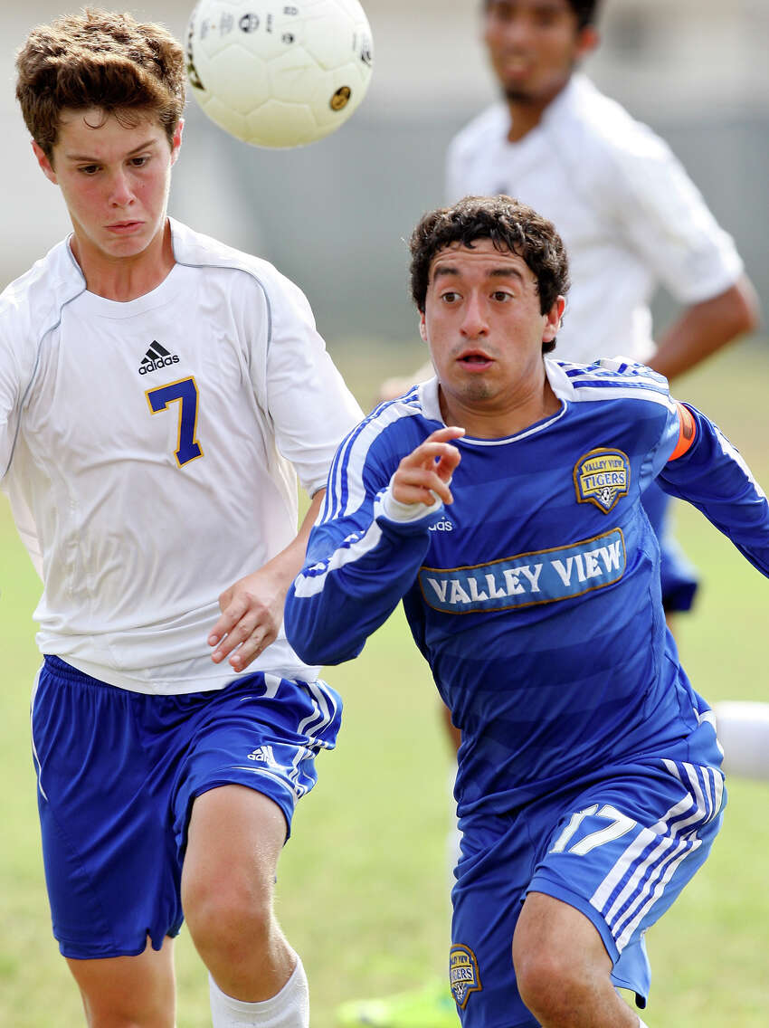 Alamo Heights' Mitch Katona and Pharr Valley View's Noe Moncada chase after the ball during second half action of their Region IV-4A final held April 14, 2012 at Cabaniss Field in Corpus Christi, Tx.