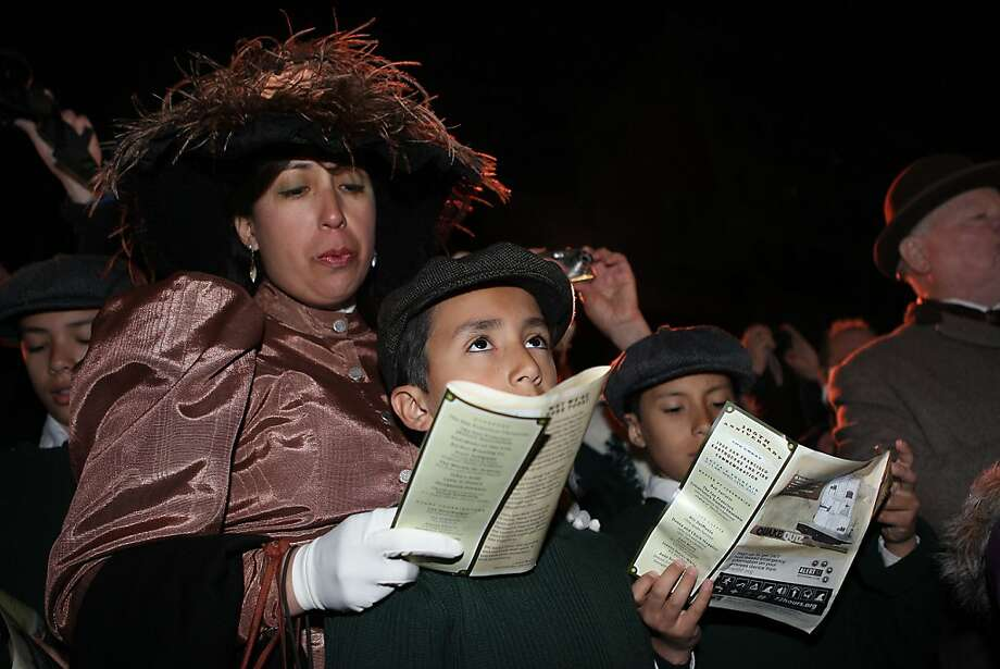 Azalia Merrell with her sons David Phineas (middle), 11 years old, and John Phineas (right), 9 years old, sing during the commemoration of the 105th anniversary of the San Francisco earthquake took place at Lotta's Fountain in San Francisco, Calif., on Monday, April 18, 2011. Photo: Liz Hafalia, The Chronicle