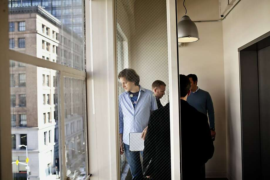 Nat Friedman, center, CEO and cofounder of Xamarin, a mobile application company, checks out office space for his company at 611 Mission Street in San Francisco, Calif., Friday, April 13, 2012.   Jason Henry/Special to The Chronicle Photo: Jason Henry, Special To The Chronicle