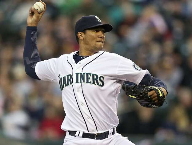 Hector Noesi #45 of the Seattle Mariners delivers a pitch during a game against the Oakland Athletics at Safeco Field on April 14, 2012 in Seattle, Washington. Photo: Stephen Brashear, Getty Images