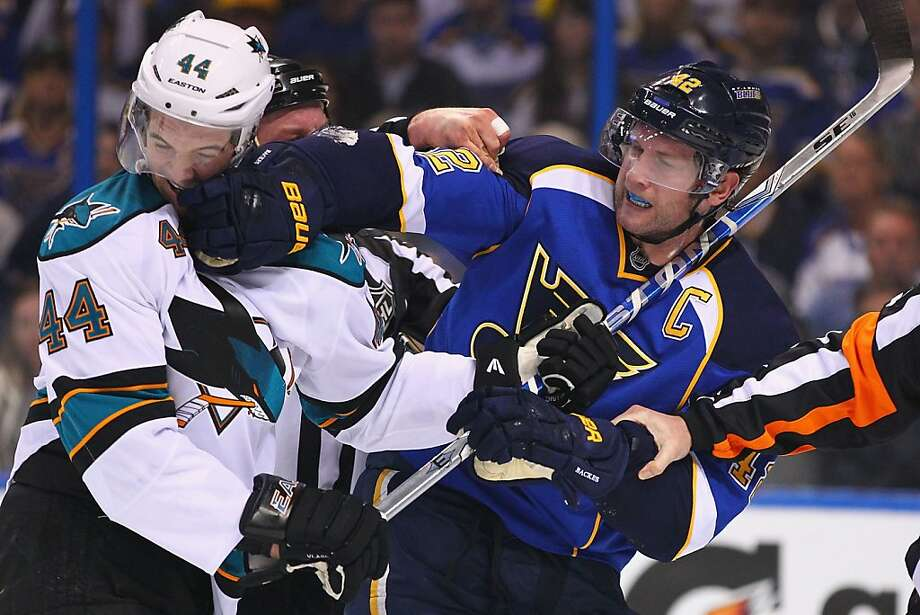 David Backes #42 of the St. Louis Blues tussles with Marc-Edouard Vlasic #44 of the San Jose Sharks during Game Two of the Western Conference Quarterfinals during the 2012 NHL Stanley Cup Playoffs at the Scottrade Center on April 14, 2012 in St. Louis, Missouri. Photo: Dilip Vishwanat, Getty Images