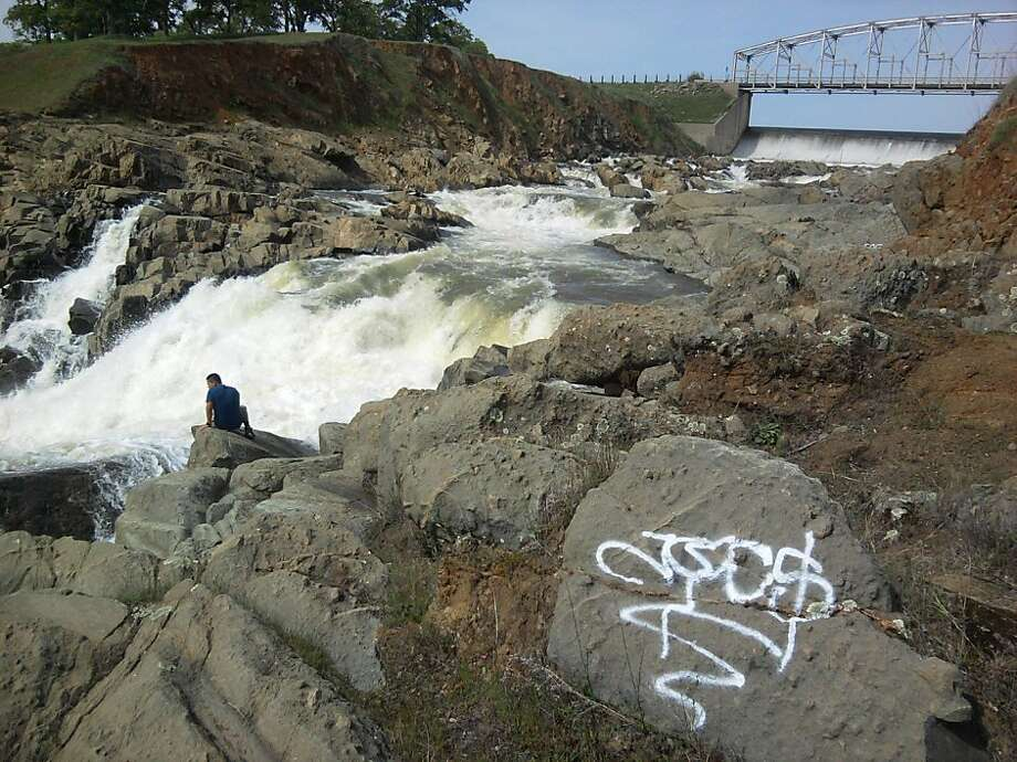 A view point for a series of cascade waterfalls below the outlet of Camp Far West Reservoir was vandalized by gang symbols spray painted on boulders. Tom Stienstra/The Chronicle Photo: Tom Stienstra, The Chronicle