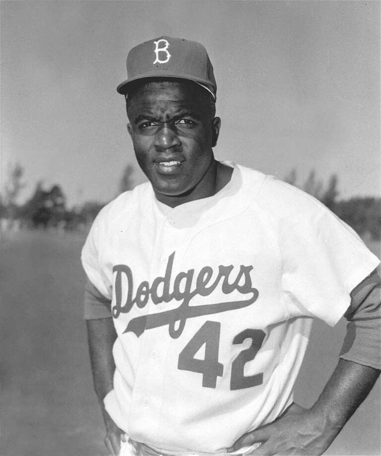 Jackie Robinson, former Brooklyn Dodger infielder, is shown in this March, 1956 file photo. Robinson will be nominated for the Congressional Gold Medal in recognition of his achievements as the first black player in Major League Baseball, the Boston Red Sox said.  (AP Photo, File)  HOUCHRON CAPTION (06/26/2004):  ROBINSON. Photo: AP / AP