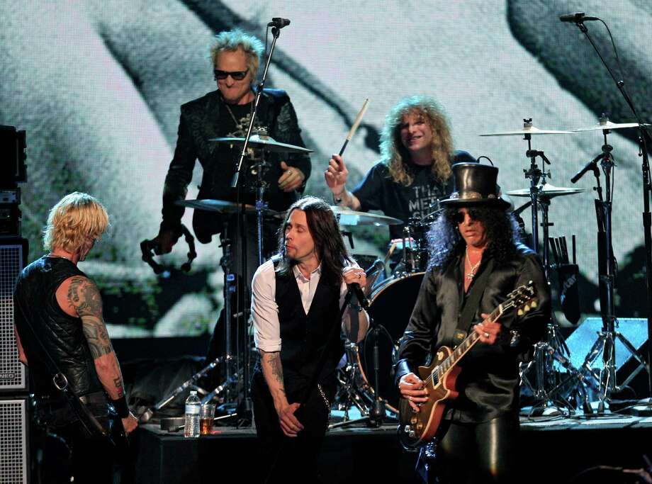 Guns N' Roses' Duff McKagan, left, Matt Sorum, top left, Steven Adler, top right, and Slash, right, perform with guest vocalist Myles Kennedy after induction onto the Rock and Roll Hall of Fame Sunday, April 15, 2012, in Cleveland. (AP Photo/Tony Dejak) Photo: Tony Dejak