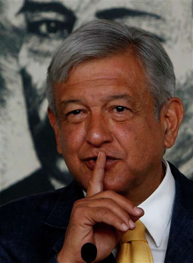 Manuel Lopez Obrador, presidential candidate for the Democratic Revolution Party, PRD, is backdropped by a painting of Benito Juarez, Mexico's first president of Indian descent and national hero, while speaking at a news conference in Mexico City, Friday April 13, 2012. Mexico will hold presidential elections on July 1. (AP Photo/Marco Ugarte) Photo: Marco Ugarte, Associated Press / AP