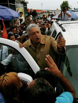 Manuel Lopez Obrador, presidential candidate for the Democratic Revolution Party (PRD), greets supporters as he campaigns in Chalco, Mexico, Friday April 13, 2012. Mexico will hold presidential elections on July 1. (AP Photo/Marco Ugarte) Photo: Marco Ugarte, Associated Press / AP