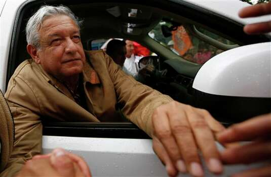 Manuel Lopez Obrador, presidential candidate for the Democratic Revolution Party (PRD), greets supporters during a rally in Chalco, Mexico, Friday April 13, 2012. Mexico will hold presidential elections on July 1. (AP Photo/Marco Ugarte) Photo: Marco Ugarte, Associated Press / AP