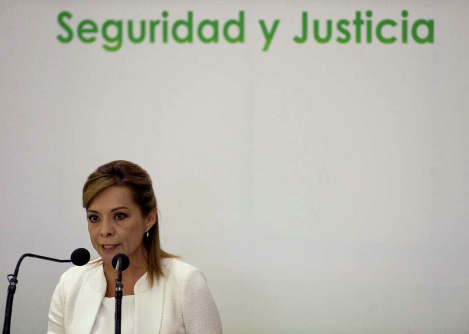 The Mexican presidential candidate of the National Action Party, Josefina Vazquez Mota delivers a speech during a meeting on insecurity and violence in the Mexican society, also attended by the other presidential candidates, in Mexico City, on April 2, 2012. AFP PHOTO/Alfredo ESTRELLA Photo: ALFREDO ESTRELLA, Getty Images / 2012 AFP