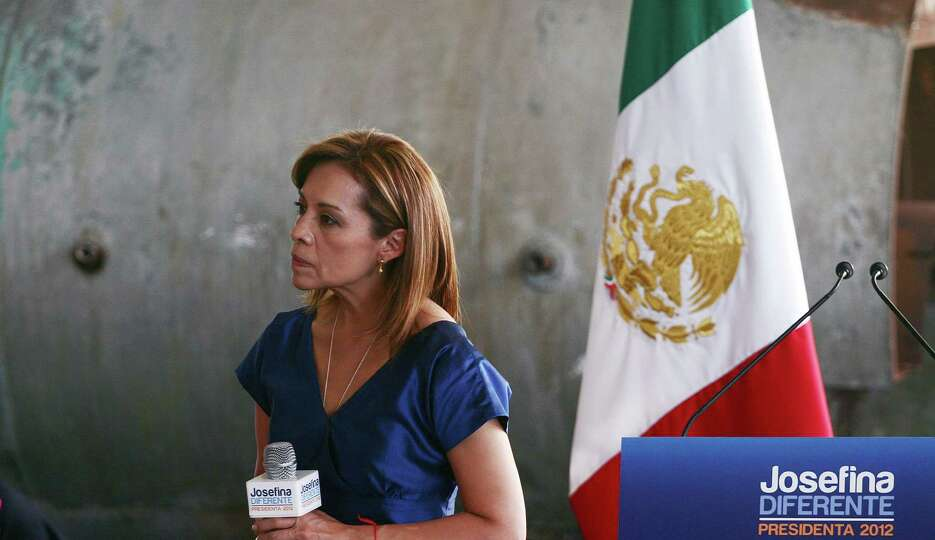 Mexican presidential candidate for the National Action Party (PAN), Josefina Vazquez Mota, listens t