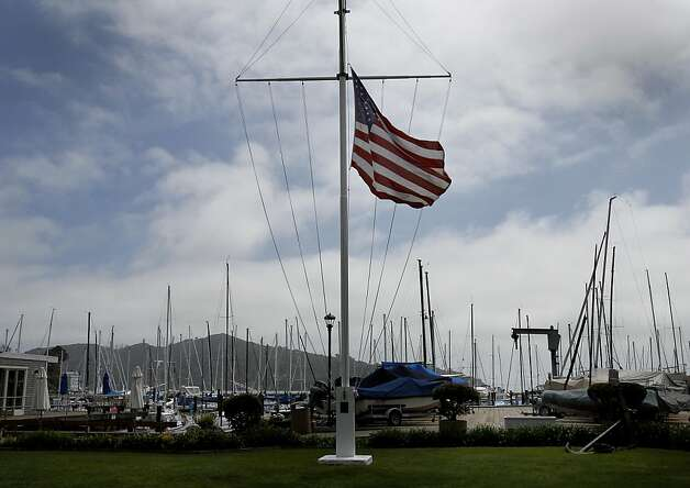 A flag at the San Francisco Yacht Club hung at half mast for the dead and missing. Members of the San Francisco Yacht Club were in mourning Sunday after the Coast Guard confirmed that one sailor was killed and four were missing after huge waves toppled the yacht Low Speed Chase at South Farallon Island during a race. Photo: Brant Ward, The Chronicle