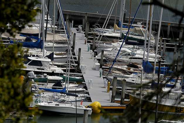 The docks at the yacht club were quiet Sunday April 15, 2012. Members of the San Francisco Yacht Club were in mourning Sunday after the Coast Guard confirmed that one sailor was killed and four were missing after huge waves toppled the yacht Low Speed Chase at South Farallon Island during a race. Photo: Brant Ward, The Chronicle