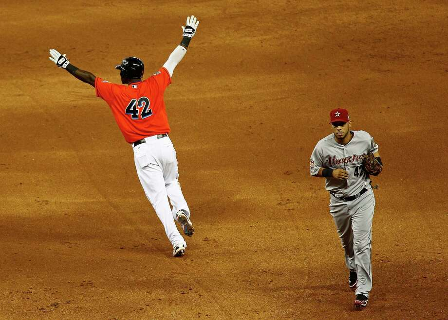 Hanley Ramirez of the Miami Marlins celebrates hitting a bases loaded walk off single in the 11th inning during a game against the Houston Astros at Marlins Park on April 15, 2012 in Miami, Florida. Both teams wore the number 42 in honor of Jackie Robinson Day. Photo: Mike Ehrmann, Getty Images / 2012 Getty Images