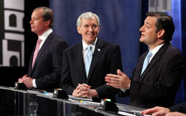 Republican candidates for U.S. Senate, Ted Cruz, right, makes a response to a question asked by a panel of journalist as Lt. Governor  David Dewhurst and Tom Leppert  listen on during the Belo Debate Friday night, April 13, 2012 at the WFAA studios in Dallas, Texas. The four are vying  for the seat of retiring Sen. Kay Bailey Hutchison.  (AP Photo/The Dallas Morning News, Brad Loper)  MANDATORY CREDIT; MAGS OUT; TV OUT; INTERNET OUT; AP MEMBERS ONLY Photo: AP