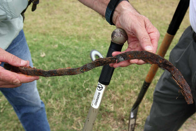 METRO -- Volunteer Modesto Silva, 66, hold an old iron chain uncovered while scanning for artifacts at a ranch in Atascosa County, Sunday, April 15, 2012.  Tejano historian and author, Dan Arellano and volunteers used the metal detectors in hopes of finding artifacts from the 1813 Battle of Medina. The battle was the bloodiest fought on Texas soil according to the Handbook of Texas. Out of the 1400 Texas Republicans, over one thousand were Tejanos and Native Americans and 300 Americans. After an ambush by a Spanish Army force of around 1830, only 100 of the Republicans survived, said Arellano. The site of the battle has never been located. Jerry Lara/San Antonio Express-News Photo: JERRY LARA, San Antonio Express-News / © 2012 San Antonio Express-News