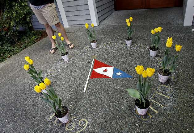 Eight yellow tulips were left near the front entrance of the club Sunday April 15, 2012. Members of the San Francisco Yacht Club were in mourning Sunday after the Coast Guard confirmed that one sailor was killed and four were missing after huge waves toppled the yacht Low Speed Chase at South Farallon Island during a race. Photo: Brant Ward, The Chronicle