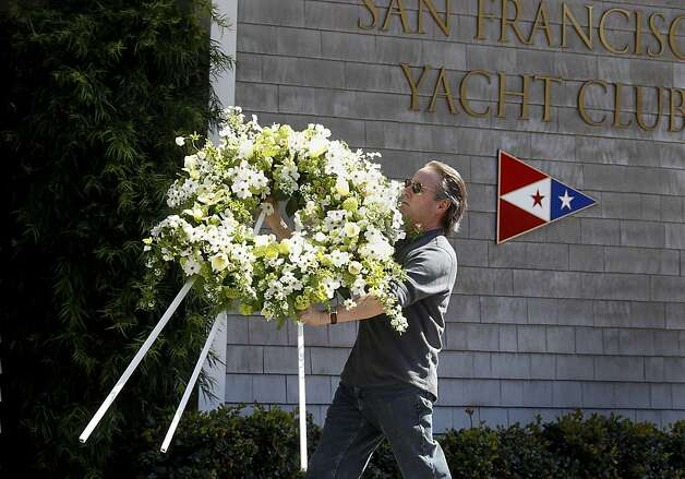 Flowers were delivered for a vigil planned for Sunday evening at the yacht club. Members of the San Francisco Yacht Club were in mourning Sunday after the Coast Guard confirmed that one sailor was killed and four were missing after huge waves toppled the yacht Low Speed Chase at South Farallon Island during a race. Photo: Brant Ward, The Chronicle
