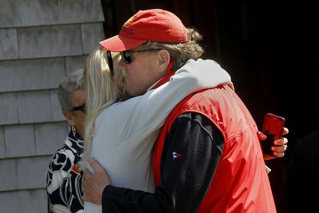 Club member Tad Lacey (right) hugged a woman outside the yacht club Sunday April 15, 2012. Members of the San Francisco Yacht Club were in mourning Sunday after the Coast Guard confirmed that one sailor was killed and four were missing after huge waves toppled the yacht Low Speed Chase at South Farallon Island during a race. Photo: Brant Ward, The Chronicle