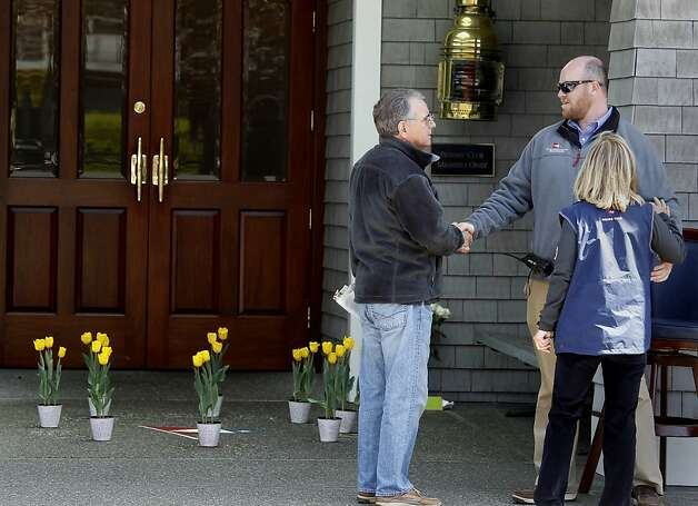 A constant stream of friends and members visited the club Sunday April 15, 2012. Members of the San Francisco Yacht Club were in mourning Sunday after the Coast Guard confirmed that one sailor was killed and four were missing after huge waves toppled the yacht Low Speed Chase at South Farallon Island during a race. Photo: Brant Ward, The Chronicle