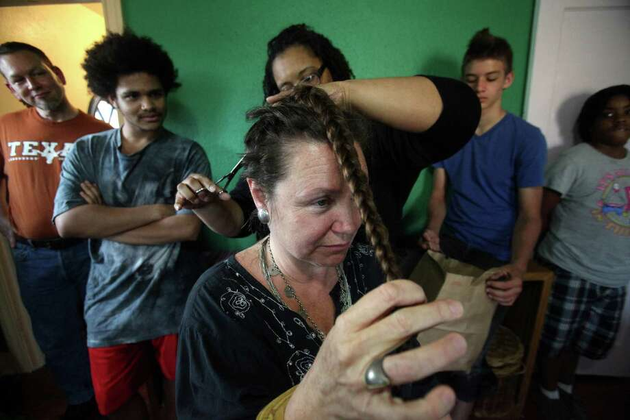 Dr. Krenie Stowe diagnosed with breast cancer, seeks to take the power from cancer by cutting her hair before the treatment takes it Alliance for Cooperative Transformation on Friday, March 30, 2012, in Houston.  Stowe is a believer in natural health care -- juicing, yoga, etc. -- and she also believes in science and chemotherapy. She is a product of the Ivy League but, like many of her patients, she has struggled to find insurance and pay for the care she needs. Photo: Mayra Beltran, Houston Chronicle / © 2012 Houston Chronicle