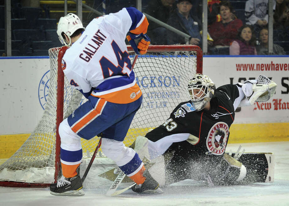 Wilkes Barre/Scranton goalie Scott Munroe makes a nice pad save on a scoring chance by Sound Tiger Brett Gallant in the second period of their AHL matchup at the Webster Bank Arena in Bridgeport on Sunday, April 15, 2012. Photo: Brian A. Pounds / Connecticut Post