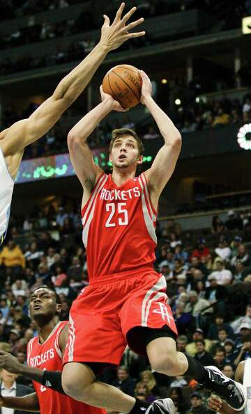 Houston Rockets forward Chandler Parsons (25) shoots against the Denver Nuggets during the first qua