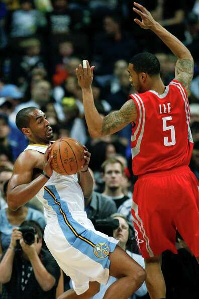 Denver Nuggets shooting guard Arron Afflalo (6) tries to maneuver around Houston Rockets shooting gu