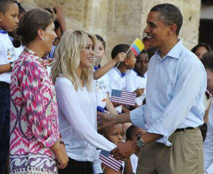 US President Barack Obama (R) greets Colombian singer Shakira (C) as Colombian First Lady Maria Clemencia Rodriguez (L) looks on during an event to hand over titles to representatives of the Afro-Colombian community during an event at the Plaza de San Pedro in Cartagena, Colombia on April 15, 2012. The land restititution is an attempt by Colombia to recognized marginalized communities who were forced from their land by armed groups. AFP PHOTO/Saul LOEB (Photo credit should read SAUL LOEB/AFP/Getty Images) Photo: SAUL LOEB / AFP