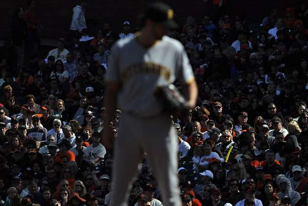 Giants fans remained quiet in the later innings as their team failed to produce any runs. The San Francisco Giants played the Pittsburgh Pirates at AT&T Park in San Francisco, Calif., on Sunday, April 15, 2012. The Giants lost 1-4. Photo: Carlos Avila Gonzalez, The Chronicle
