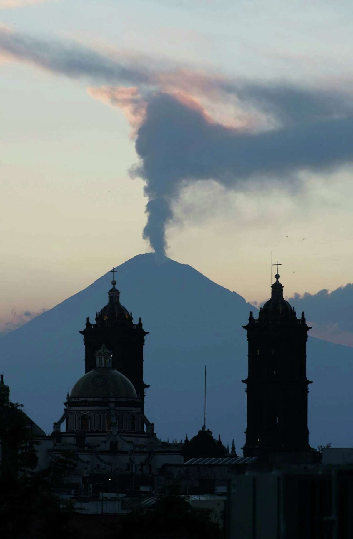 A plume of steam rises from the Popocatepetl volcano seen from the city of Puebla, Mexico, Saturday April 14, 2012. An early morning exhalation from the volcano sent ashes to towns near the area as moderate activity at the volcano continues. (AP Photo/Joel Merino)