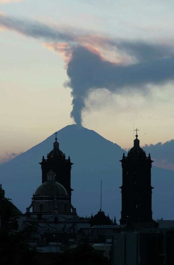 A plume of steam rises from the Popocatepetl volcano seen from the city of Puebla, Mexico, Saturday April 14, 2012.  An early morning exhalation from the volcano sent ashes to towns near the area as moderate activity at the volcano continues. (AP Photo/Joel Merino) Photo: Joel Merino / AP