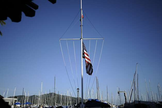 The flag flies at half mast.  A vigil was held at the San Francisco Yacht Club in Belvedere, CA Sunday April 15th 2012 Photo: Michael Short, Special To The Chronicle