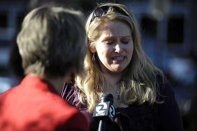 An unidentified woman cries as she speaks with reporters after leaving the vigil.  A vigil was held at the San Francisco Yacht Club in Belvedere, CA Sunday April 15th 2012 Photo: Michael Short, Special To The Chronicle